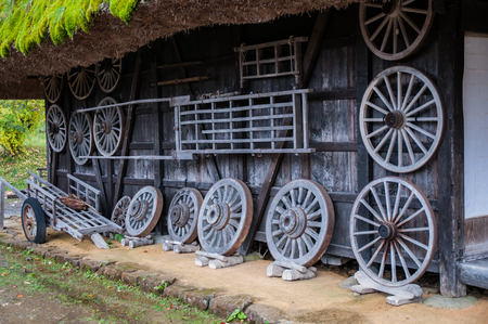 Old wagon wheels at Hida Folk Village in Takayama 写真素材