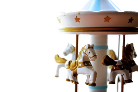 Detail of carillon of horses on white background