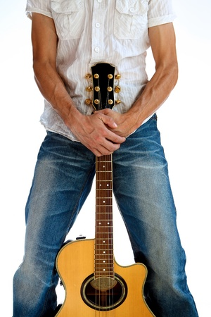 Guitarist is holding the guitar with his hands joined photo