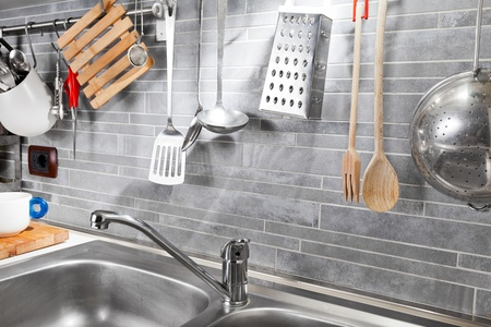 lavabo: Kitchen tools on a grey tile marble wall from above  Stock Photo