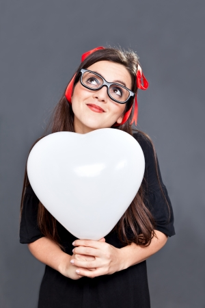 lolita: Lolita girl is dreaming about her love with a heart balloon in her hands