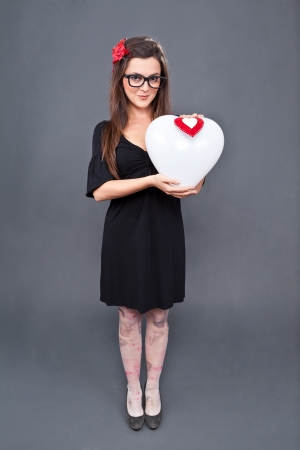 lolita: Little lolita girl standing with a heart balloon in her hands Stock Photo