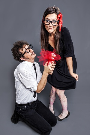 nerd gives a gift to his nerd girl photo