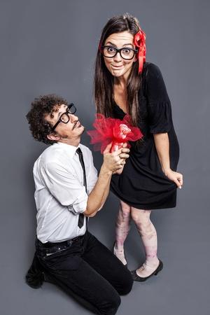 nerd gives a gift to his nerd girl Banco de Imagens