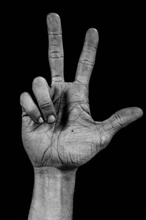 number three composed by a grunge hand isolated on black background Stock Photo - 19494414