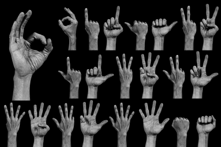 collection of numbers and sings composed by hands and fingers isolated on black background photo