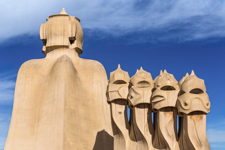 Gaudìs sculptures similar to humans faces on the rooftop of La Pedrera in Barcelona Banco de Imagens