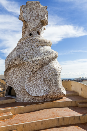 sinuous: Gaudìs sinuous sculpture covered by a mosaic on the rooftop of La Pedrera in Barcellona Stock Photo