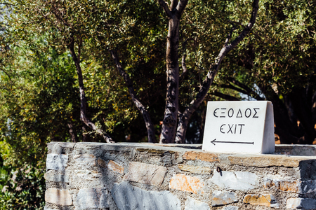 exit sign made of stone in the Acropolis of Athens