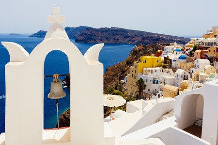 Glimpse of the Greek town of Oia on the island of Santorini, with the typical local building