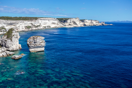 Top cliff view of a bay with its stack rock and its rocky bottom Banco de Imagens