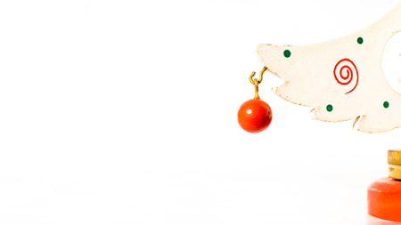 Christmas white ticket decorated with a wooden red ball hanging on a branch of a wooden toy Christmas tree