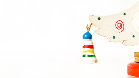 Christmas white ticket decorated with a wooden gift hanging on a branch of a wooden toy Christmas tree