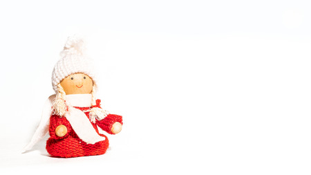 Christmas white ticket decorated with a wooden child puppet dressed in red with a white hat and a white scarf
