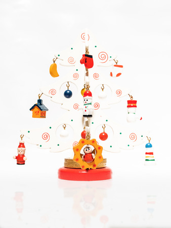 Christmas white ticket decorated with a wooden toy Christmas tree