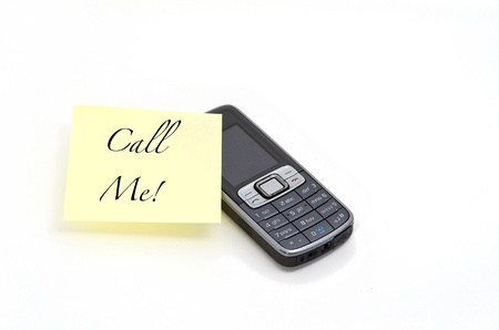 yellow memo with call me message on a mobile phone Stock Photo - 9664960
