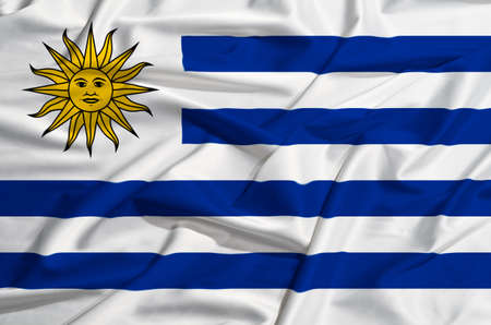 uruguay flag: Uruguay flag on a silk drape waving Stock Photo