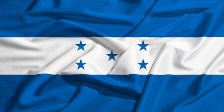 bandera honduras: Bandera de Honduras en una s�bana de seda ondeando Foto de archivo