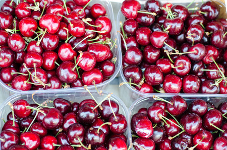 cherries on a desk of a market in italy