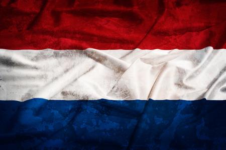 Netherland grunge old flag on a silk drape photo