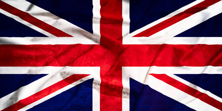 United Kingdom grunge and old flag on a silk drape waving photo