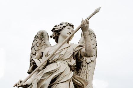Marble statue of angels in rome, italy photo