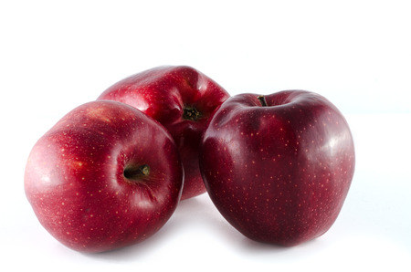 red stark apples isolated on white background