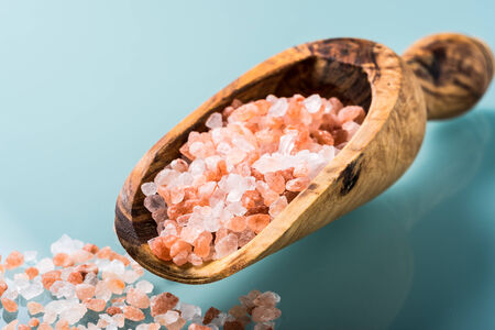 himalayan pink salt on a olive wood spoon photo