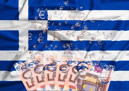 euro banknote dissolving as a concept of economic crisis in greece photo