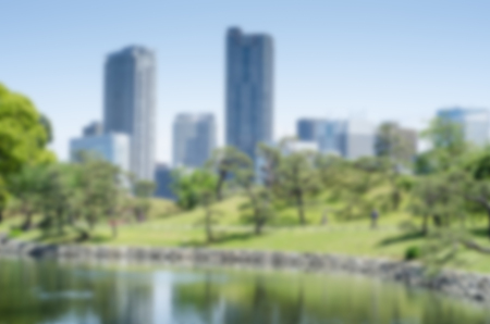 intentionally: Intentionally blurred background of a city and garden on sunny day Stock Photo