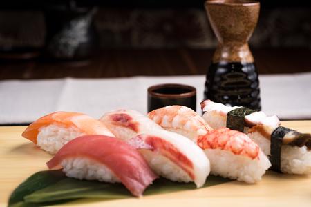 sushi: fresh nigiri sushi in a plate in a jtraditional japanese restaurant