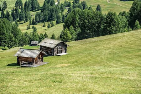 wooden house in mountain landscape of alto adige, northern italy Lizenzfreie Bilder