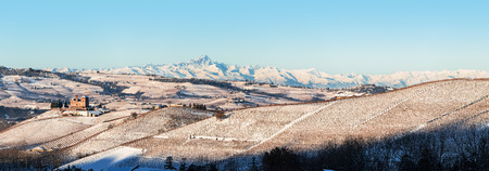 Panoramic view of Castle of Grinzane and mount Viso in northern italy, winter, langhe region, piedmont Standard-Bild
