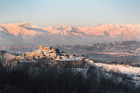 Roddi castle and mountains in northern italy,on winter, langhe region, piedmont