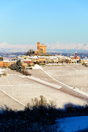 Serralunga castle in langhe region of northern Italy in winter with vineyards Editorial