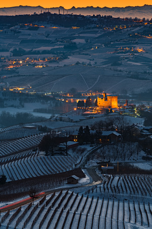 Grinzane  Castle  panoramic view in Langhe Region in winter during blue hour, italy