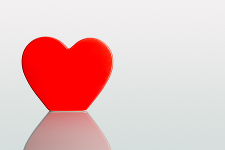 Valentine big heart on a plain pastel background as greeting card and copyspace