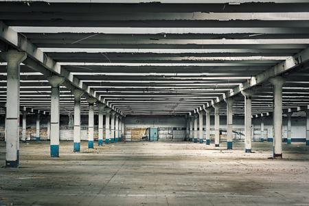 Interior of abandoned industry with dir, rusty thinghs,broken bricks
