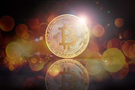 golden bitcoin background with bokeh and flare as concept of global crypto-currency Standard-Bild