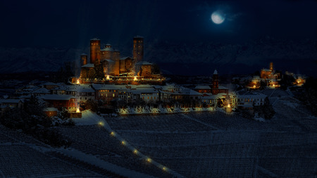 Fantasy photomanipulation of medieval landscape in winter on night with castle and cities Editorial
