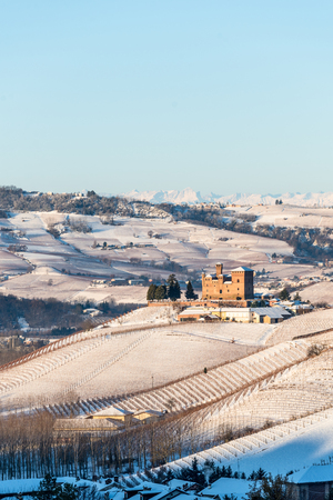Grinzane Cavour castle and mountains in northern italy, langhe region, piedmont,vertical