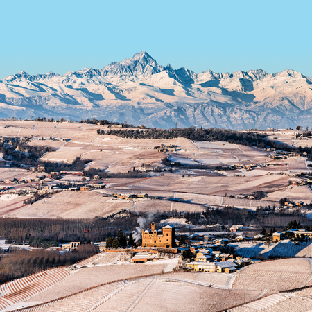 Grinzane Cavour castle and mountains in northern italy, langhe region, square format