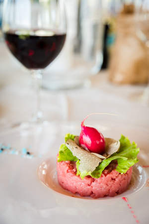 raw veal meat with truffle, italian food