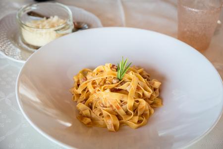 dish of ragout tagliatelle handmade in a restauarnt, italian food Banco de Imagens