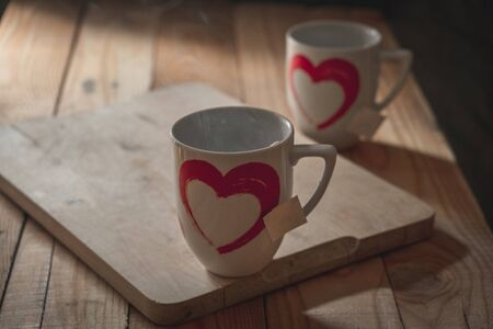 two cups of tea with a heart designed in a quiet and rustic atmosphere Zdjęcie Seryjne