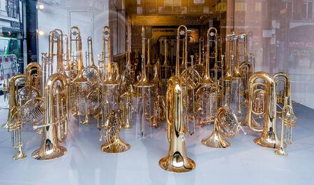 showed: Lot of trumpets showed in shop in London