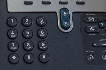 p2p: a phone in the office with dial buttons