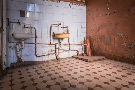 A very old bathroom with rusty pipes Stock Photo