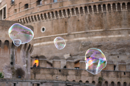 tevere: Colorful soap bubbles and the vatican in background (castel santangelo)