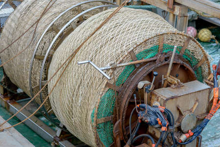 seaport: nets and stuff for fish on fishing boat in seaport